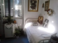 """""""In this room Saint Nektarios of Aegina, the Metropolitan of Pentapolis and Wonderworker, reposed venerably on the night of Sunday 8 November 1920. Here also he did his first miracle after his repose to a sick man."""""""